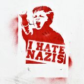 BERLIN - AUGUST 16: Anti-fascist graffiti on a  building wall (I hate nazis) August 16, 2012 in Berl