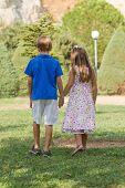Little Friends Walk Holding Hands
