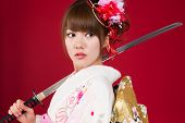 Beautiful japanese kimono woman with japanese sword
