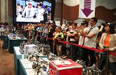 SUBANG JAYA - NOV 10: Unidentified visitors and supporters cheer their team on at the World Robot Ol