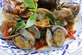 stir fried clams with roasted chili paste and thai sweet basil, thai cuisine