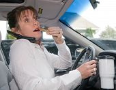 Woman Multitasking While Driving