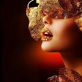 Luxury Golden Makeup. Beautiful Professional Holiday Make-up. Sexy Gold Lips.Fashion Art Portrait.Jewelry