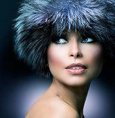 Winter Fashion. Fur Hat. Beautiful Girl in Furry Hat. Winter Woman Portrait poster