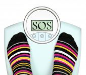 Woman' s feet on weighing scale