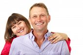 Attractive cheerful woman with man in love smiling over white background. Portrait of happy mature wife hugs her husband, isolated