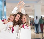 Three young women in a happy shopping expedition