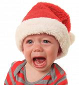 Crying Santa baby boy, 10 months old.
