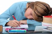 stock photo of inappropriate  - Tired child doing homework - JPG