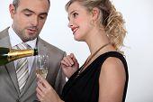 Woman serving champagne
