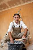 Man mixing plaster