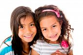 Beautiful little girls smiling - isolated over a white background