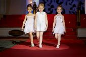 MOSCOW - JAN 26: Little girls walk the runway during children fashion show Stillini Ball of Colours,