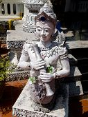 foto of peace-pipe  - Man with pipe statue in Thai molding art  - JPG
