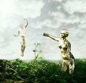 stock photo of garden eden  - Beautiful fantasy background that represent two golden statues like Adam and Eve in the garden of Eden - JPG