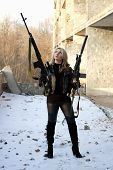 stock photo of m16  - Armed strong blond young woman outside the building - JPG