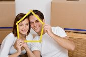 Young Couple In First New Home Concept