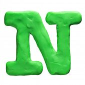 Plasticine letter N isolated on a white background