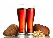 two glasses of kvass and rye breads with ears, isolated on white