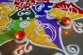 stock photo of swastik  - Drawn drawn by sprinkling colored powders rangoli are a custom in hindu household during divali and festive occasions for example new year