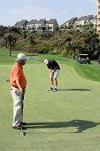 Senior Citizens Playing Golf