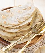 India vegetarian food plain chapatti roti or Flat bread. Indian food on dining table.