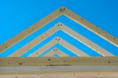 foto of rafters  - Rafters of the roof frame of a house under construction - JPG
