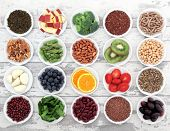foto of kidney beans  - Large super food selection in white porcelain dishes over distressed white wooden background - JPG