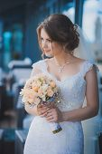 happy bride with a wedding bouquet