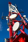 foto of antenna  - Red and White Long Telecommunication Tower with Antennas - JPG