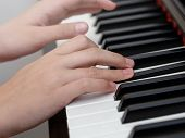 Close Up Photo Of Girls Hands Playing On Piano