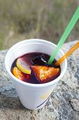 Wine Cocktail With Fruits (sangria) In Plastic Cup