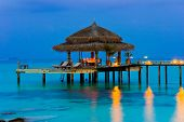 pic of kuramathi  - Water cafe at evening lights ocean and sky - JPG