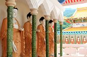 Rolls of Mahayana-styled Buddhas along the Cloister at the Buddhist Temple of Supreme Bliss : Kek Lo