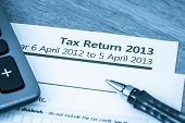 picture of self assessment  - Cool toned image of UK income tax return form for 2013 - JPG