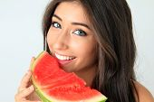 Beautiful smiling young woman with a slice of watermelon.