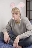 Funny Portrait Of Young Man Wearing Cap With Mouse Ear