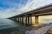stock photo of virginia  - An early morning view of the Bay Bridge as seen from the Virginia Beach side of the Chesapeake Bay - JPG