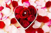 Rose and diamond ring inside the heart shape bowl
