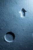 Arrow and circle shapes on styrofoam background texture