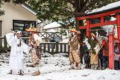 NAGANO, JAPAN - FEB 4, 2013: Shinto Ascetics perform ancient rites during a procession. Known as Yamabushi, they are mountain hermits with a long tradition of mysticism.