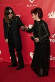 LOS ANGELES - JAN 24:  Ozzy Osbourne, Sharon Osbourne at the 2014 MusiCares Person of the Year Gala