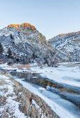 winter sunset over Cache la Poudre River (North Fork) at Eagle Nest Open Space in northern Colorado