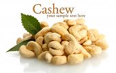 tasty cashew nuts with leaves, isolated on white