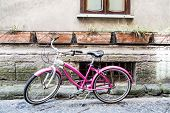 Pink Bike On Stone Wall
