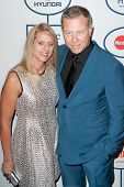 BEVERLY HILLS, CA. - JANUARY 25: James Hetfield & wife Francesca arrive at the Clive Davis & The Recording Academy annual Pre-GRAMMY Gala on January 25th 2014 at the Beverly Hilton in Beverly Hills.