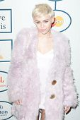BEVERLY HILLS, CA. - JANUARY 25: Miley Cyrus arrives at the Clive Davis and The Recording Academy an