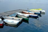 Small Boats Docked To A Pier