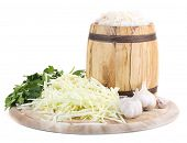 Marinated cabbage (sauerkraut), in wooden barrel, isolated on white