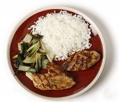 Skinless chicken breasts marinaded in soy sauce and olive oil, served with sauteed bok choi asian cabbage and white Thai jasmine rice.